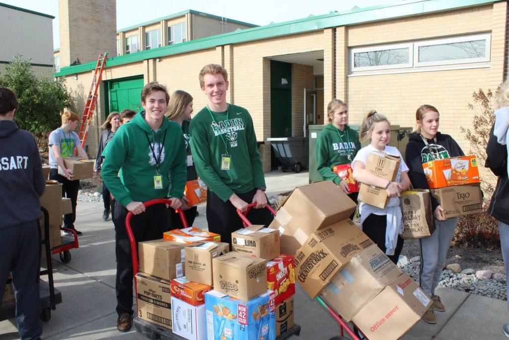 Students at Badin High School in Hamilton collect food for the needy.