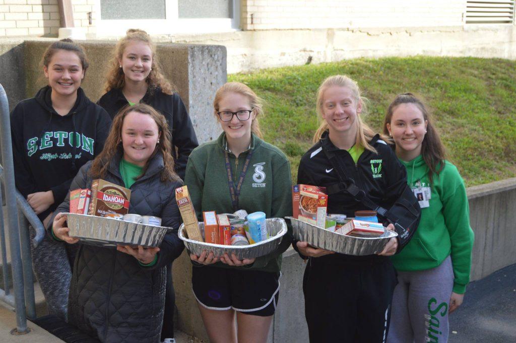 Students at Seton High School at hard work preparing Thanksgiving Dinners