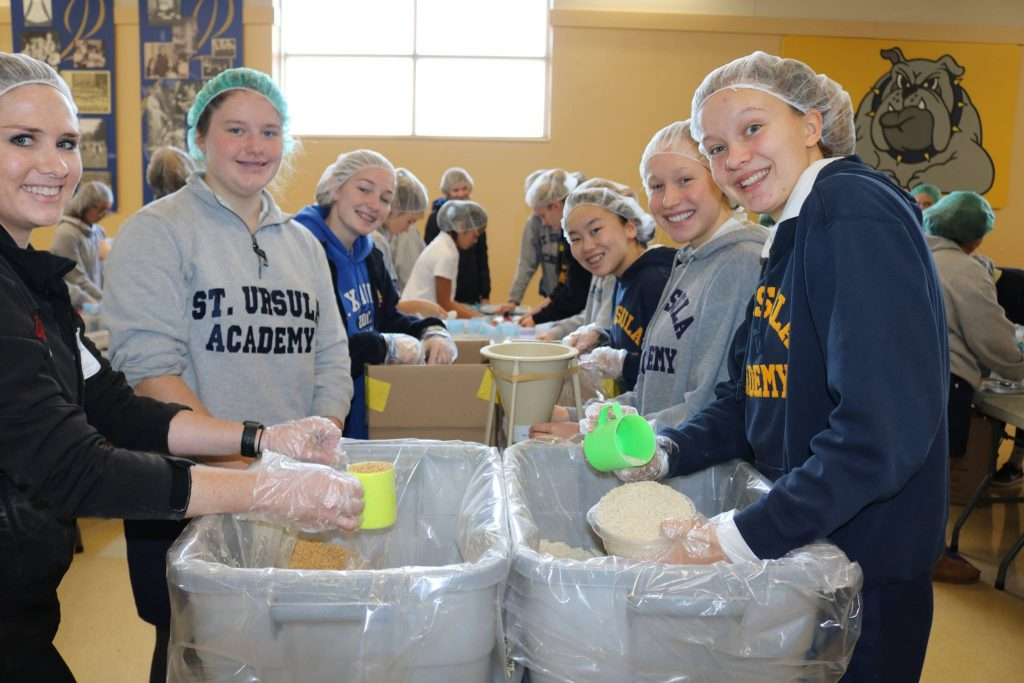 St. Ursula Academy prepares food for people in Africa.