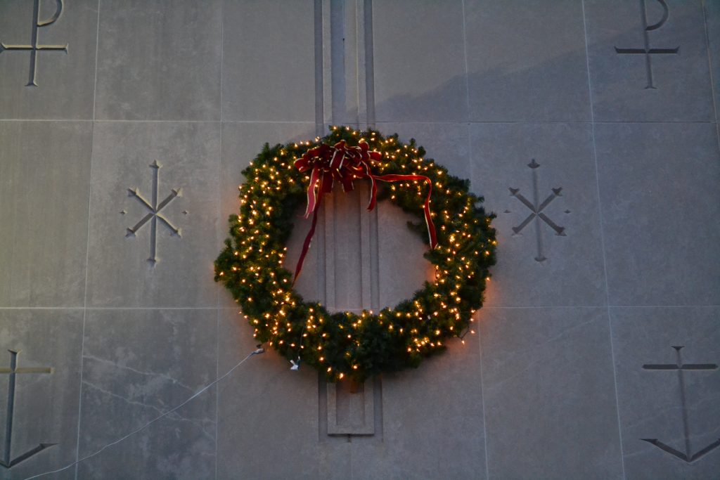In the darkness a wreath emits light at St Thomas More. (CT Photo/Greg Hartman)