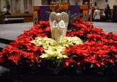 The Guardian Angel surrounded by seasonal Poinsettias awaiting the Christmas Season (CT Photo/Greg Hartman)