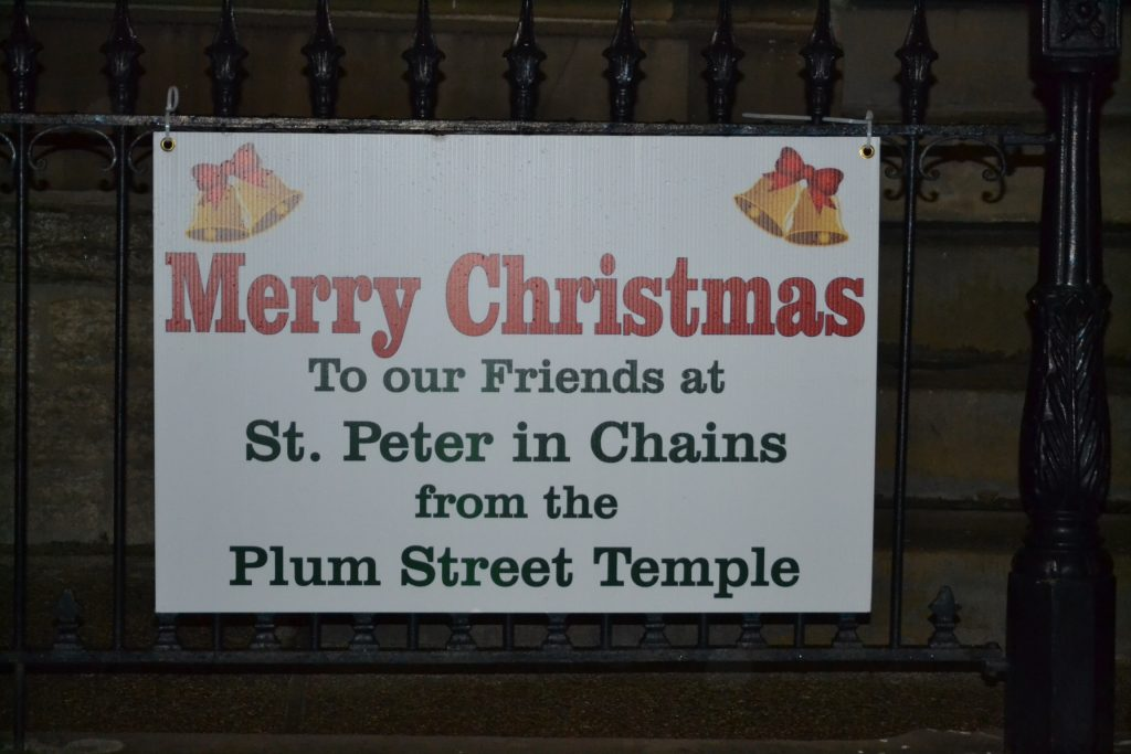 The Plum Street Jewish Temple across the street from St. Peter in Chains Cathedral sends Merry Christmas Greetings (CT Photo/Greg Hartman)