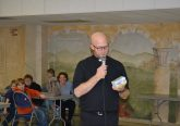 Father Kyle Schnippel giving the viewing party participants a primer before the show. (CT Photo/Greg Hartman)