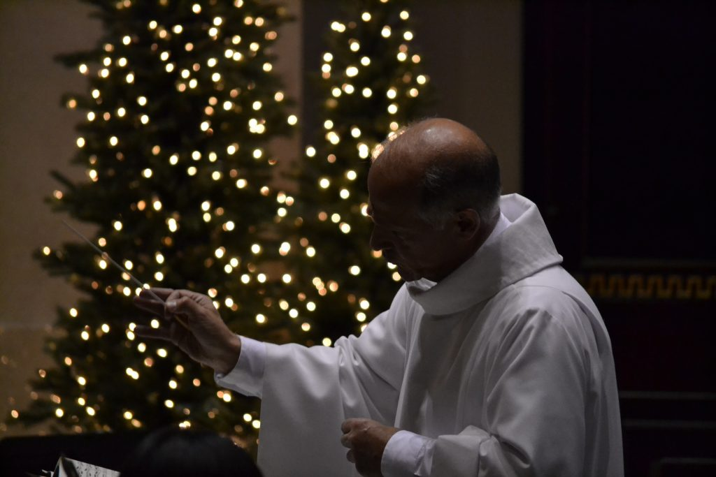 Anthony DiCello, Cathedral Music Director, conducts The Choir of St. Peter in Chains Cathedral (CT Photo/Greg Hartman)