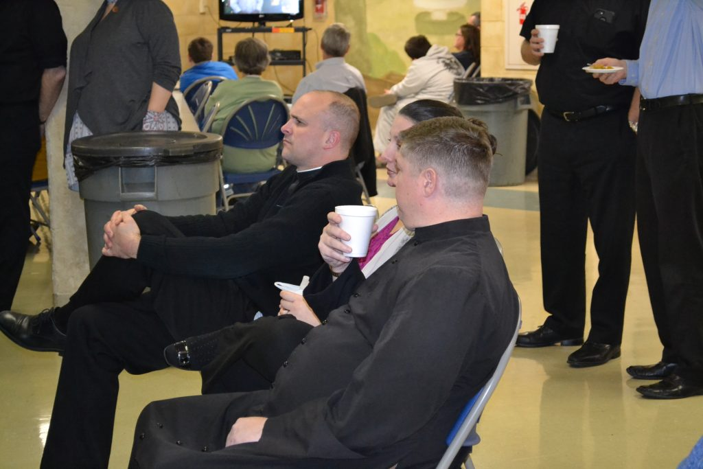 Enjoying the watch party at St. John Neumann (CT Photo/Greg Hartman)