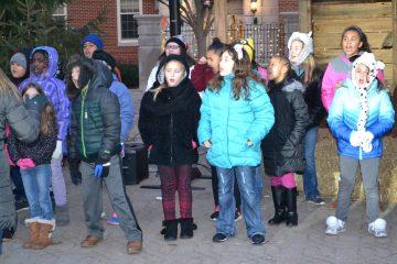 Festive carols sung awaiting the lighting of the Christmas Tree (CT Photo/Greg Hartman)