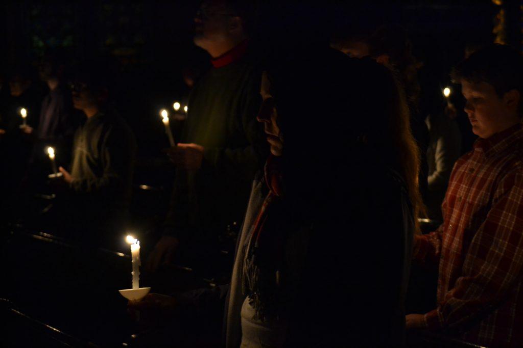 Points of light in a darkened church (CT Photo/Greg Hartman)