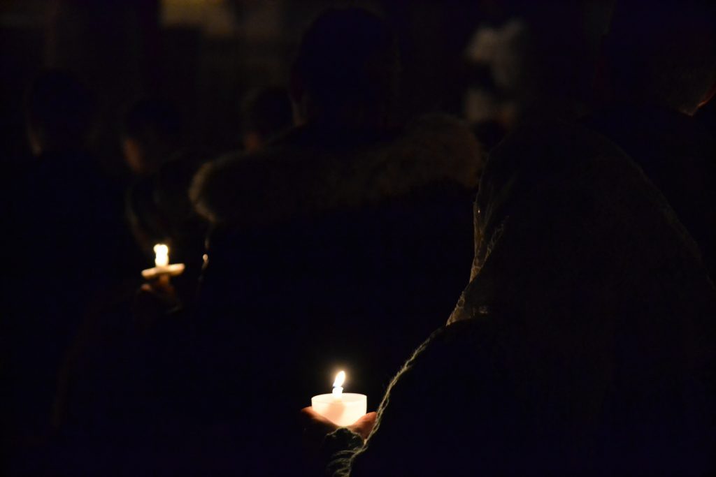 The darkness is broken by candle light. (CT Photo/Greg Hartman)