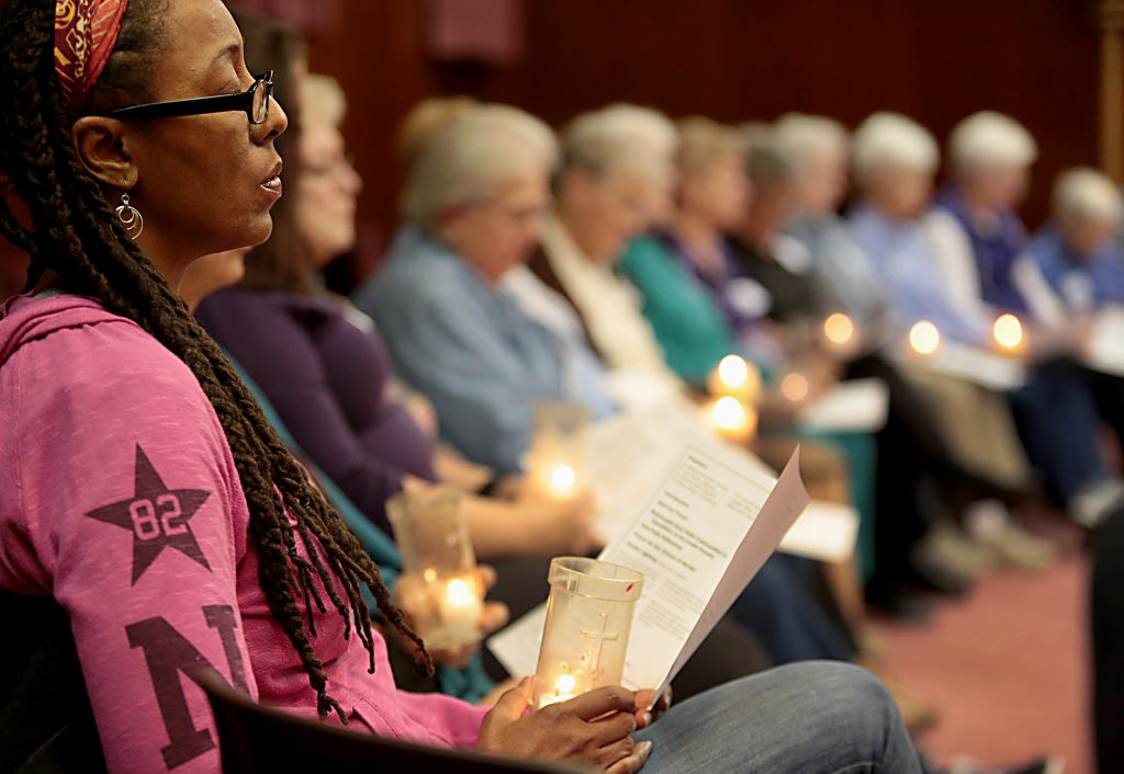 Deborah Robinson, from New Thought Unity Center in Cincinnati, holds her candle during the interfaith Cities for Life Prayer Vigil to End the Use of the Death Penalty at St. Peter in Chains Cathedral in Cincinnati Thursday, Nov. 30, 2017. (CT Photo/E.L. Hubbard)