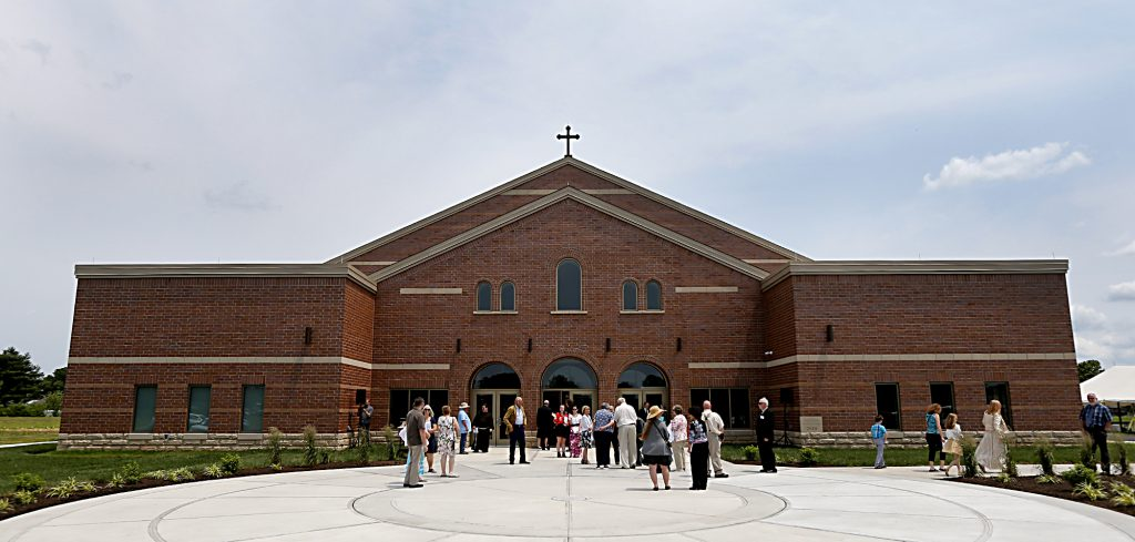 Parishioners begin to gather in front of their new building for the dedication of St. John the Baptist Church in Harrison Saturday, June 1, 2019. (CT Photo/E.L. Hubbard)