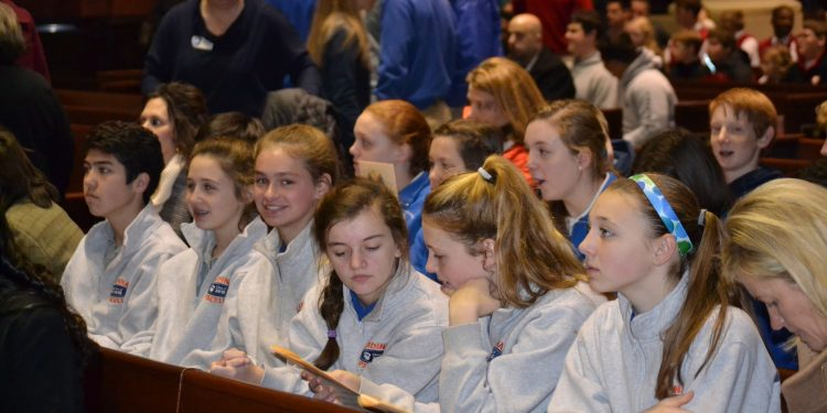 Students settle in and await the start of Catholic Schools Week Mass. (CT Photo/Greg Hartman)