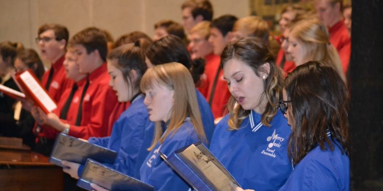 Mother of Mercy Vocal Ensemble with La Salle Vocal Ensemble and McAuley Vocal Ensemble singing at the 2018 Catholic Schools Week Mass (CT Photo/Greg Hartman)