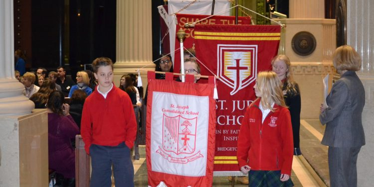 Students from St. James the Greater in the Procession of School Banners (CT Photo/Greg Hartman)