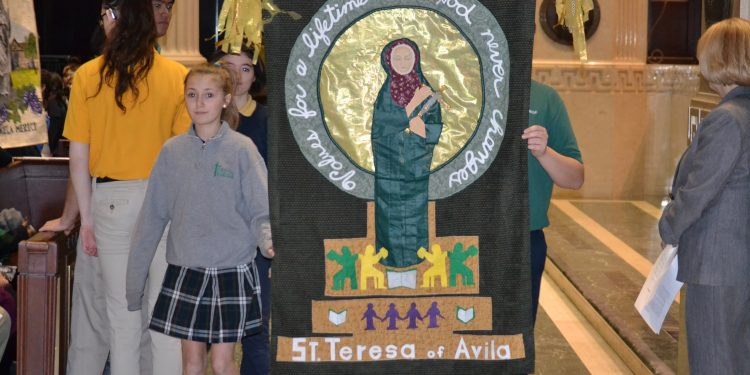 Representing St. Teresa of Avila School, students carry their banner (CT Photo/ Greg Hartman)