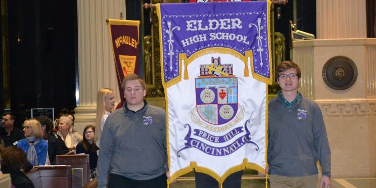 Men of Elder carry their banner in the Procession of Banners. (CT Photo/Greg Hartman)
