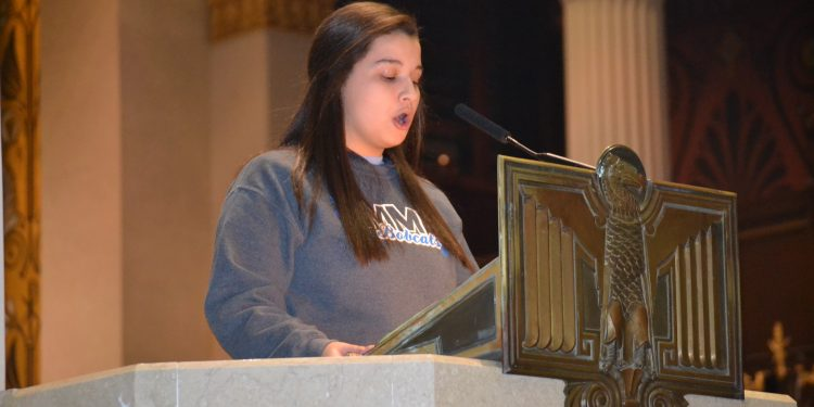 The First Reading was read by Alexis Kemble of Mercy High School (CT Photo/Greg Hartman)