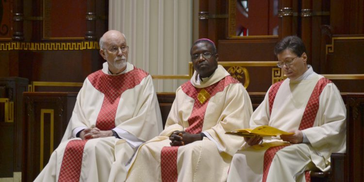 Seated from left to right, Father Len Wenke, Bishop Emmanuel Abbo from Cameroon, Deacon Mark Machuga. (CT Photo/Greg Hartman)