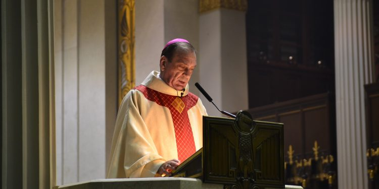 "Archbishop Dennis M. Schnurr's homily message ""So be prepared for the lightning bolt,"" he said. ""It might happen! But at the same time, be attentive to lightning bugs."" (CT Photo/Greg Hartman)"