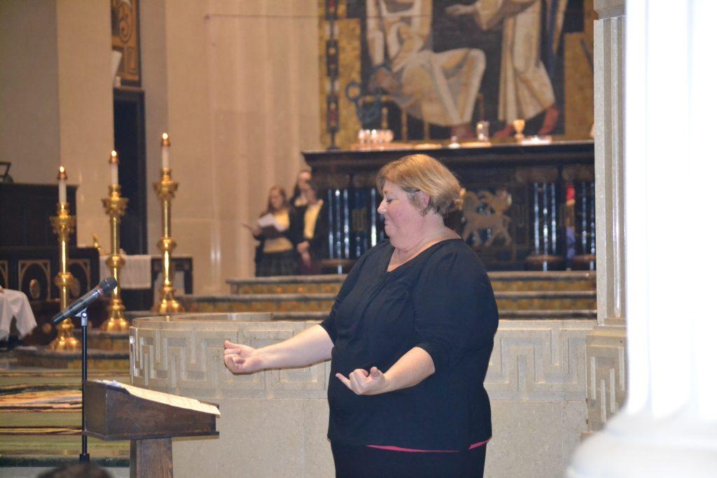 Signing at the Catholic Schools Week Mass (CT Photo/Greg Hartman)