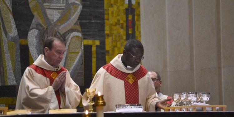 Archbishop Dennis M. Schnurr and Bishop Emmanuel Abbo of Cameroon during the Eucharistic Prayer. (CT Photo/Greg Hartman)