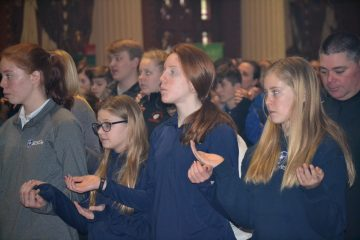 Praying at Mass a strong part of a Catholic Schools Education. (CT Photo/Greg Hartman)