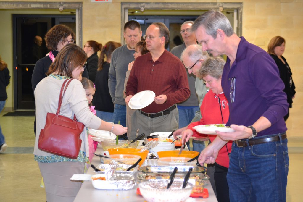 Guests line up for a feast of chicken and Vodka Penne (CT Photo/Greg Hartman)