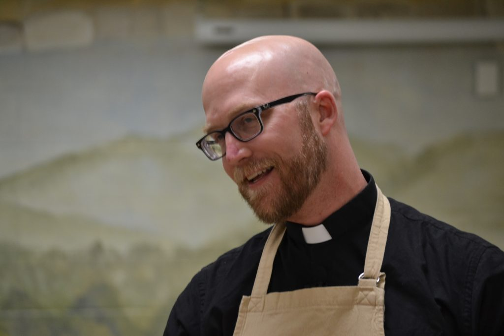 "Father Kyle Schnippel during the ""cook off"" at St. John Neumann Parish (CT Photo/Greg Hartman)"