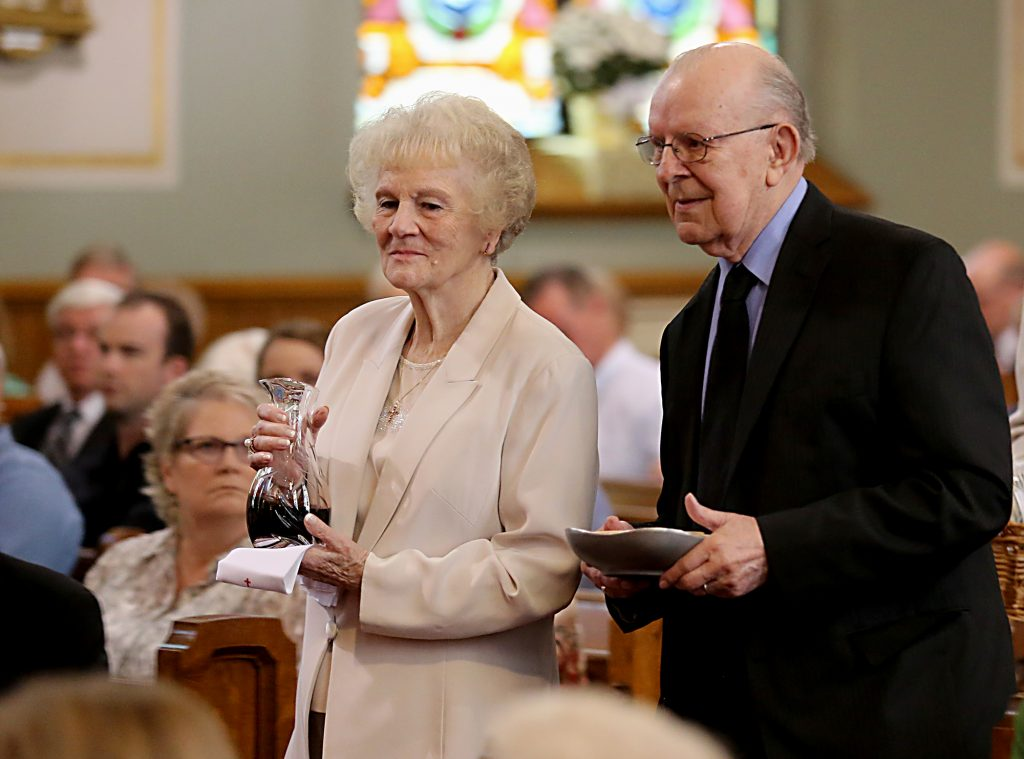 Dottie and Jim Bruck bear the Gifts during the 150th Anniversary Mass at St. Joseph Church in Hamilton Saturday, Sept. 16, 2017. (CT Photo/E.L. Hubbard)