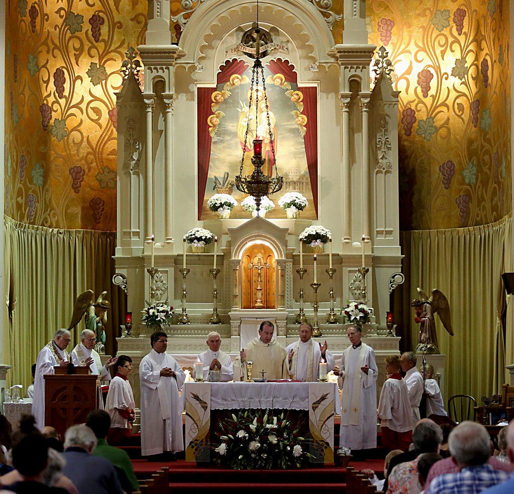 Archbishop Dennis Schnurr and the concelebrating priests prepare the Holy Eucharist during the 150th Anniversary Mass at St. Joseph Church in Hamilton Saturday, Sept. 16, 2017. (CT Photo/E.L. Hubbard)
