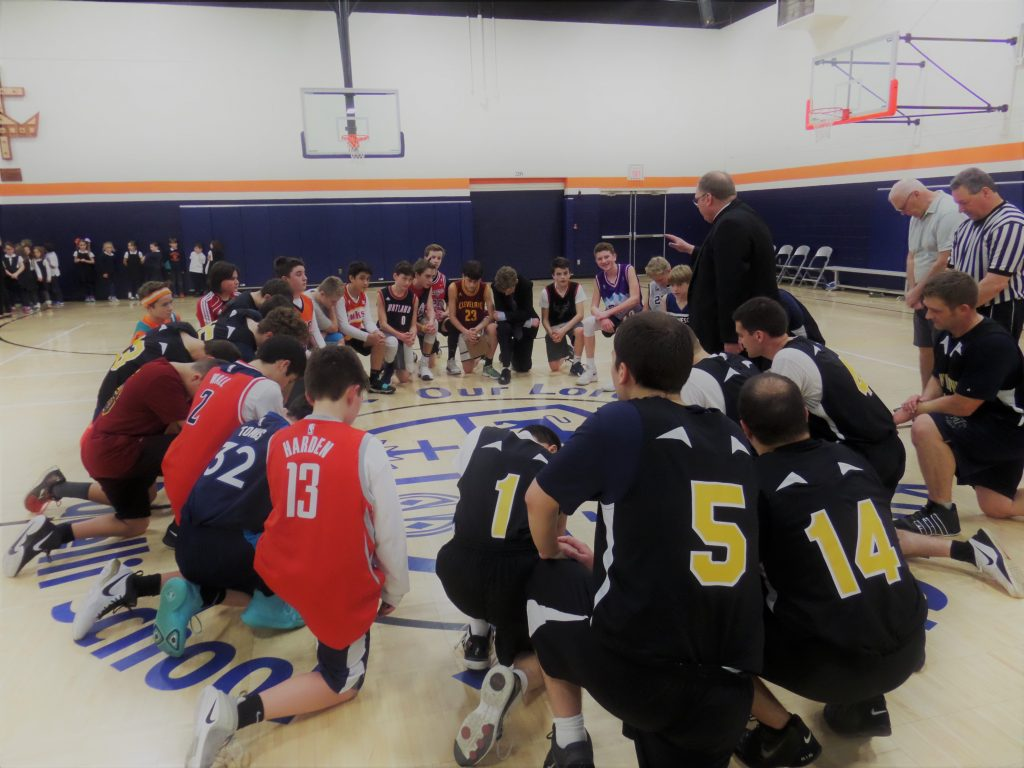 Prayer Break during hoops game between Cardinal Pacelli & mount Saint Mary's Seminary (Courtesy Photo)