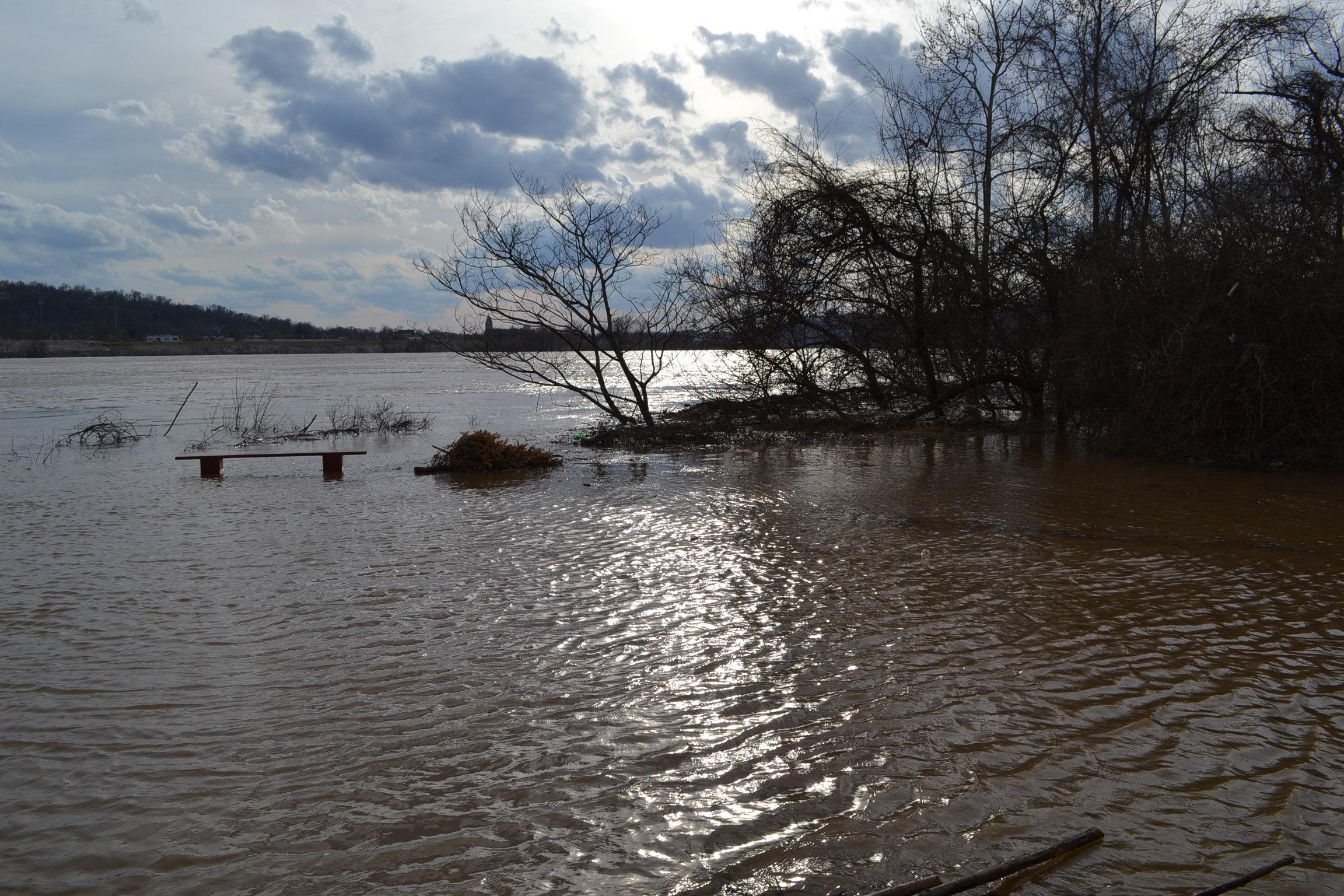 Floodwaters encroach St. Rose's parking lot. (CT Photo/Greg Hartman)