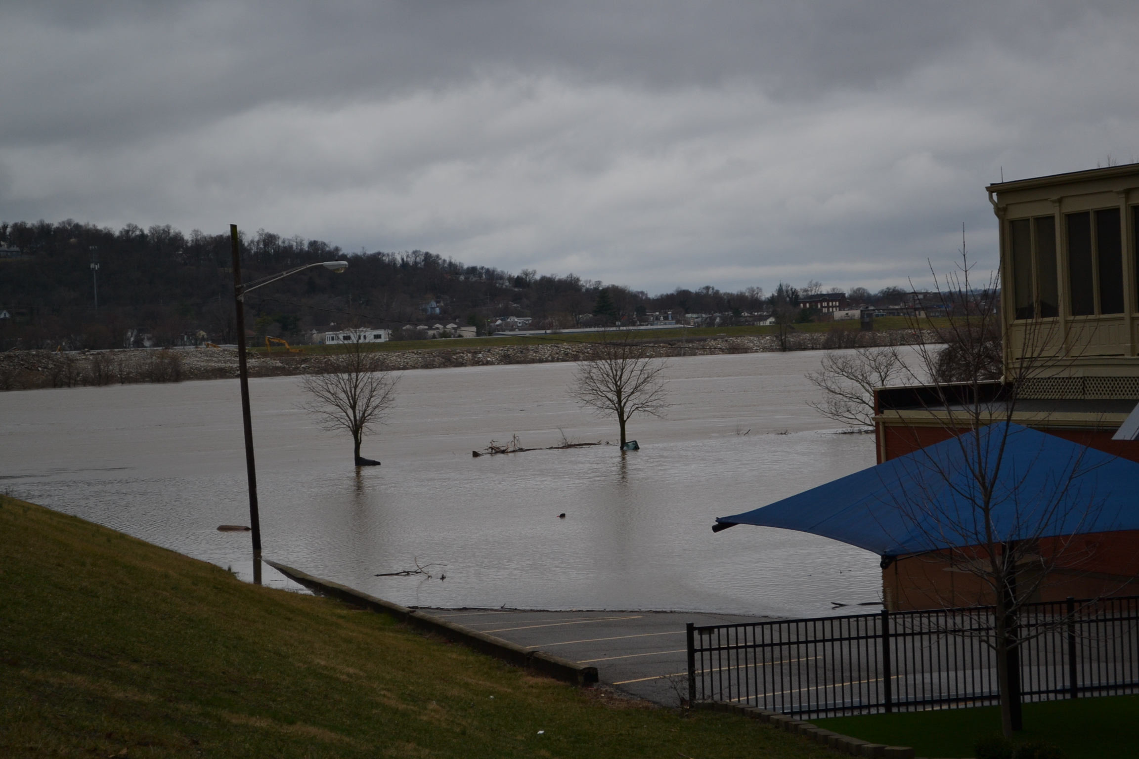 The view from Riverside Dr in Cincinnati as the Ohio River covers the parking lot at St. Rose. (CT Photo/Greg Hartman)