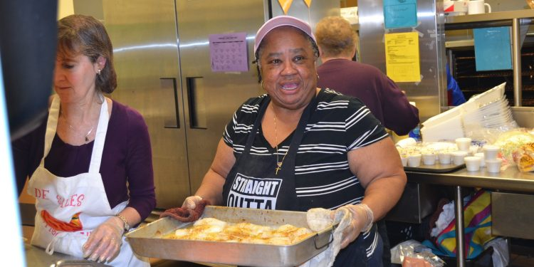 Another hardworking night at St. Francis DeSales Fish Fry. Mrs. Rosetta McDowell-cook, school receptionist, mother and grandmother to many SFDS alumni (including Daniel Powell and Isaiah Smiley!)., Mrs. Tamiko Smiley-PTO president, PK teacher, alum and daughter of Mrs. McDowell!, (CT Photo/Greg Hartman)