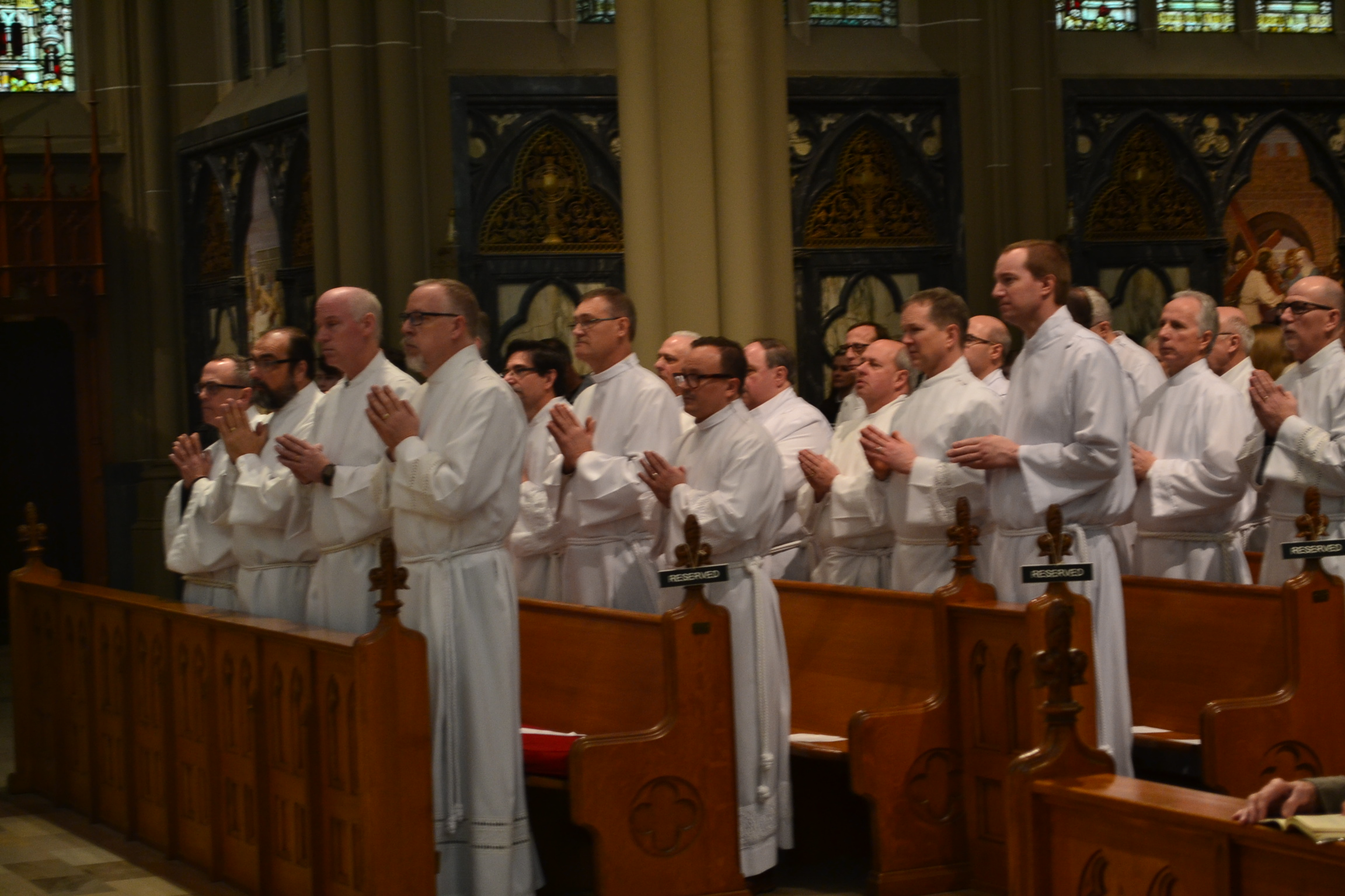 Men being introduced during the Acolyte Ceremony at the Basilica in Covington KY (CT Photo/Greg Hartman)