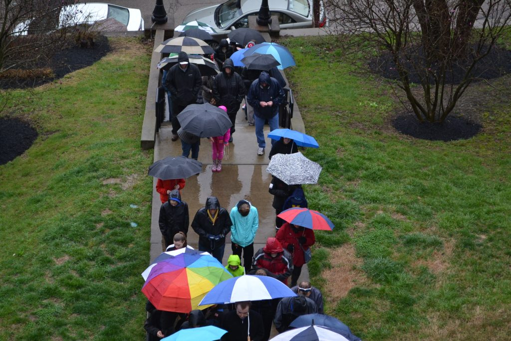 The final ascent begins off St. Gregory Street in Mt. Adams. This year umbrellas were a must for the journey. (CT Photo/Greg Hartrman)