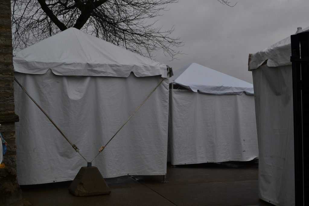 Three tents were set up for confession at Holy Cross Immaculata Church. (CT Photo/Greg Hartman)