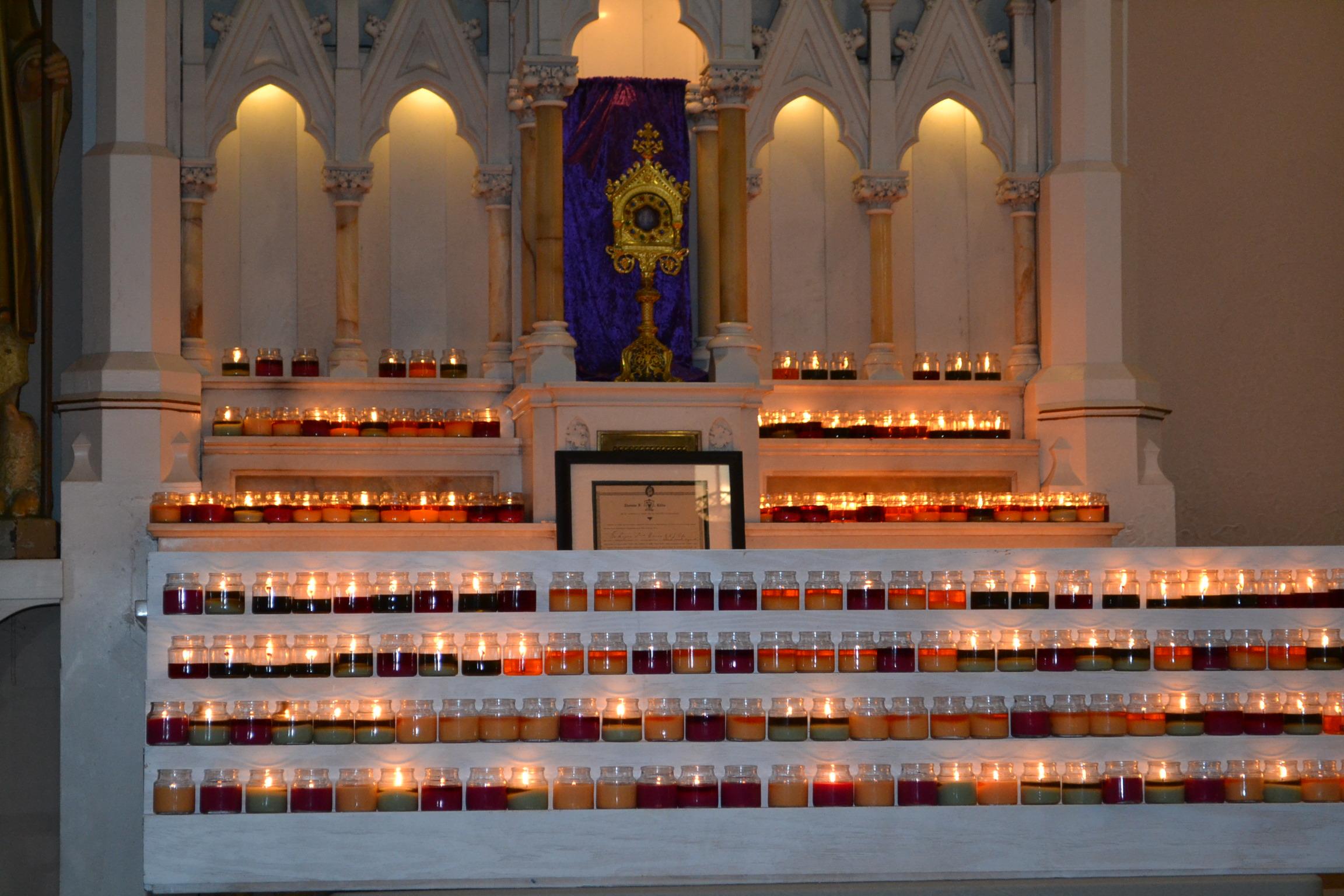 Upon entering the church, pilgrims left lit candles inn the sanctuary (CT Photo/Greg Hartman)