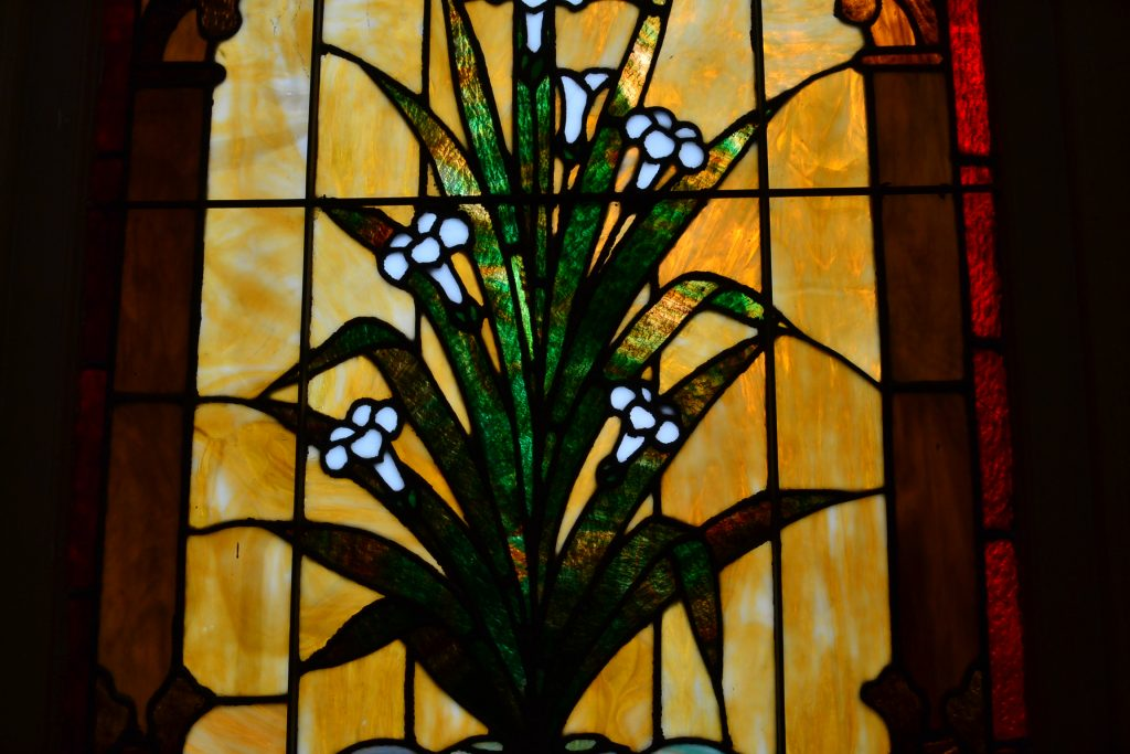 As pilgrims exited the church, a stain glass of an Easter Lily gives the great hope of the resurrection. (CT Photo/Greg Hartman)