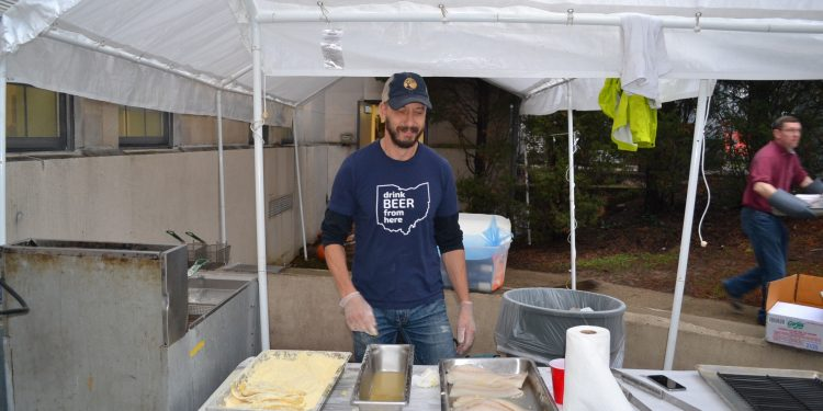 Another of literally hundreds of volunteers working the Fish Fry at Our Lord Christ the King (CT Photo/Greg Hartman)