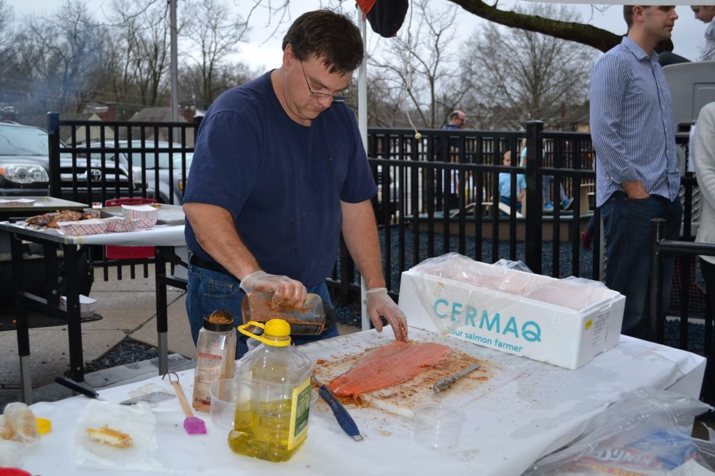 """""""Honey Badger"""" prepares fresh salmon for the Our Lord Christ the King/Cardinal Pacelli Fish Fry (CT Photo/Greg Hartman)"""
