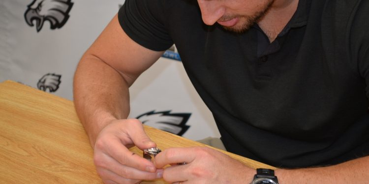 Brent examines some Lancer bling from State Championships. (CT Photo/Greg Hartman)