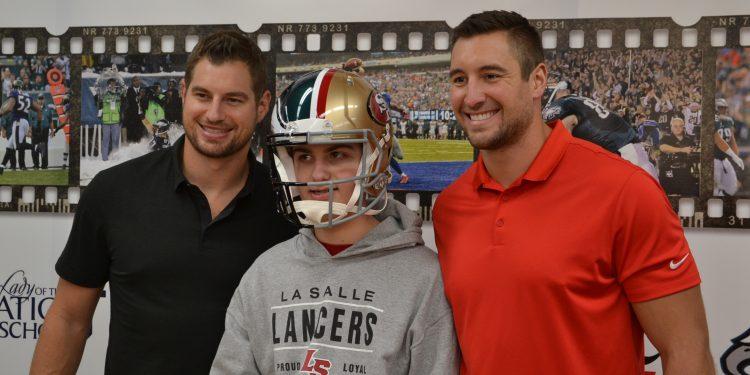 Brent & Garrett Celek pose with a Lancer, (Note the Eagle/49er helmet) (CT Photo/Greg Hartman)