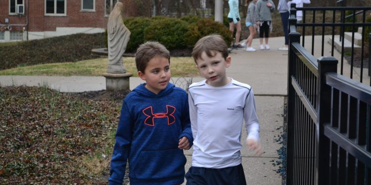 Friendships in and around Cardinal Pacelli school during a nice Fish Fry Night. (CT Photo/Greg Hartman)