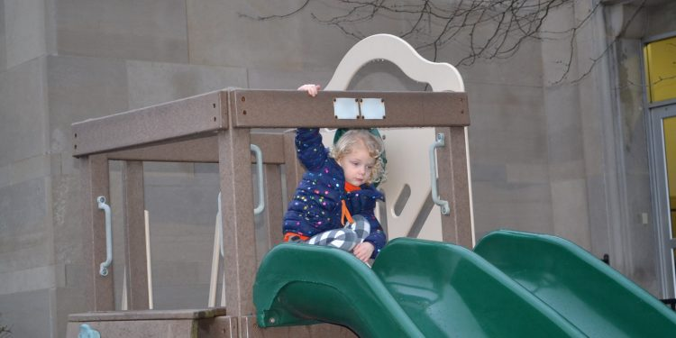 A slide is always fun in the playground on a warm for February Friday Fish Fry Night at Cardinal Pacelli School (CT Photo/Greg Hartman)