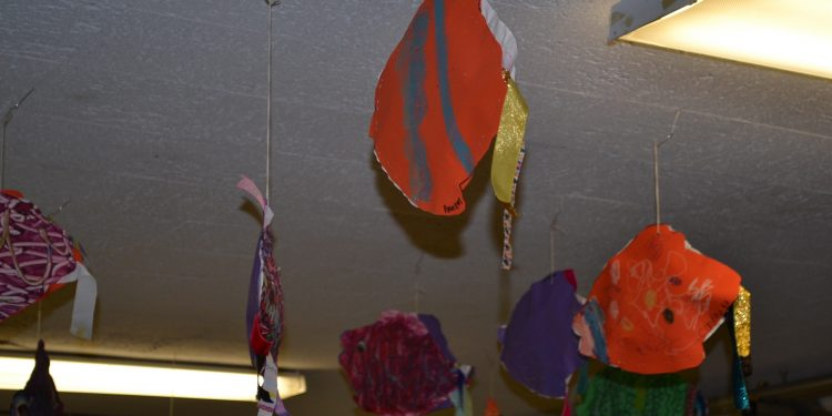 The cafeteria area was decked out with fish artwork at the Cardinal Pacelli Fish Fry (CT Photo/Greg Hartman)