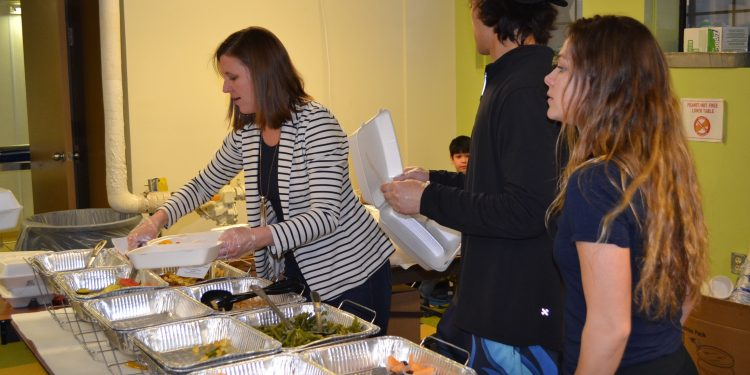 Lots to choose from for carry-out orders as workers enthusiastically feed many (CT Photo/Greg Hartman)