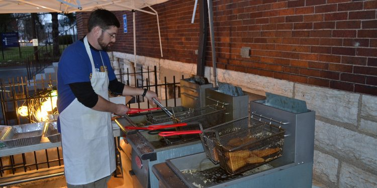 Kenny Haber oversees the fish at St. Cecilia Fish Fry in Oakley (CT Photo/Greg Hartman)
