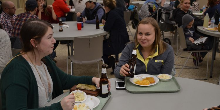 Caught! Two young women having fun at the St. Cecilia Fish Fry (CT Photo/Greg Hartman)
