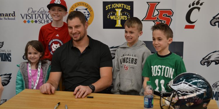 The McLaughlins pose with Brent Celek (CT Photo/Greg Hartman)