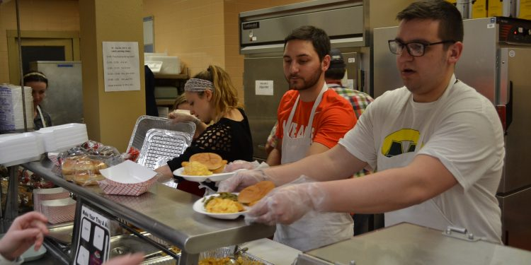 From left to right your St. Cecilia Fish Fry Crew, Sarah Rose Sperduto, fiance J.P. Bort, and Jason Hinson serve up Fish Fry delights (CT Photo/Greg Hartman)